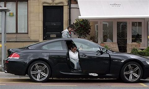 Cristiano Ronaldo leaving his car, a BMW M6