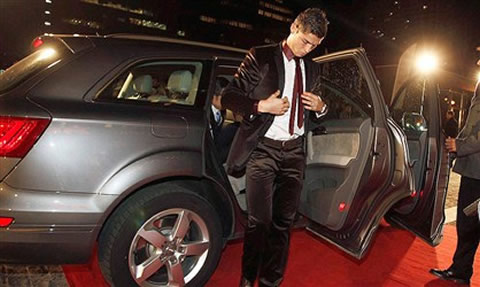 Cristiano Ronaldo getting out of his Audi Q7 car