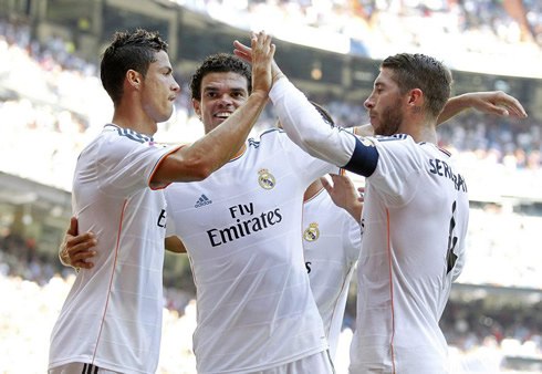 Cristiano Ronaldo celebrating Real Madrid goal with hairy Pepe and Sergio Ramos, in 2013-2014