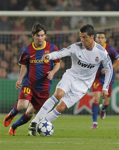 Cristiano Ronaldo hiding the ball from Messi