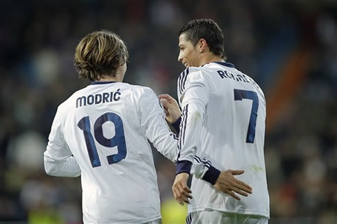 Luka Modric putting his hand on Cristiano Ronaldo ass, during a game for Real Madrid in 2013