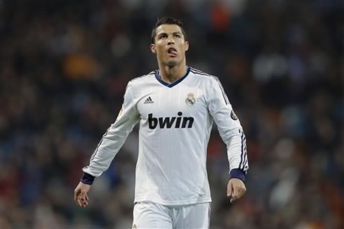 Cristiano Ronaldo licking his lips with his tongue, as he heads back to Real Madrid half, in the Copa del Rey 2013