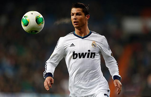 Cristiano Ronaldo looking at the ball bouncing in front of him, in Real Madrid 2013