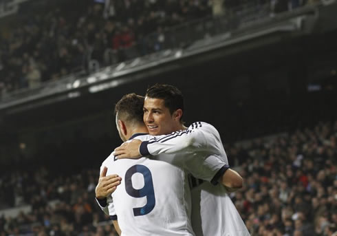 Cristiano Ronaldo friendship hug to Karim Benzema, after scoring another goal for Real Madrid against Celta de Vigo, in the Copa del Rey 2012-2013
