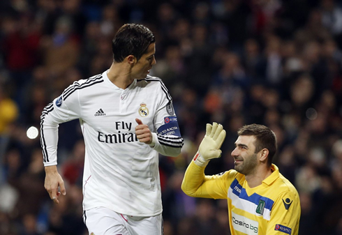 Cristiano ronaldo looking at the goalkeeper he just scored against