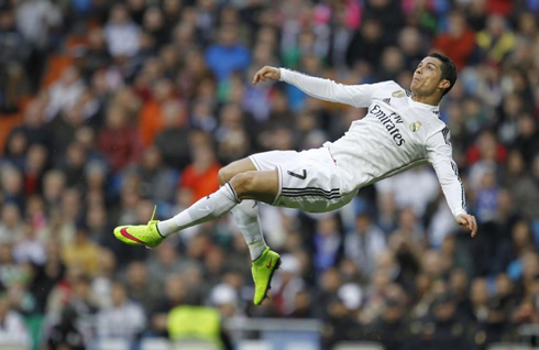 Cristiano Ronaldo rises in the air for an acrobatic shot, in Real ...