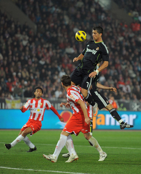Cristiano Ronaldo holds on the air