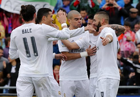 Real Madrid players celebrating James Rodríguez goal by hugging each other
