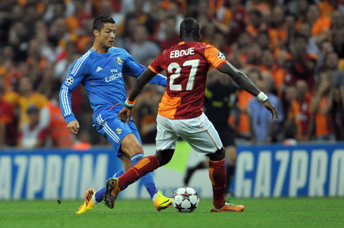 Cristiano Ronaldo takes on Eboué, in Galatasaray vs Real Madrid, in 2013