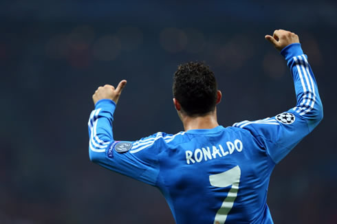Cristiano Ronaldo raises his two thumbs as a sign of approval to his teammates in Real Madrid