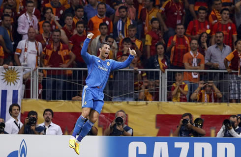 Real Madrid turns his back to the Turkish Galatasaray fans and jumps to celebrate his hat-trick and Real Madrid goal