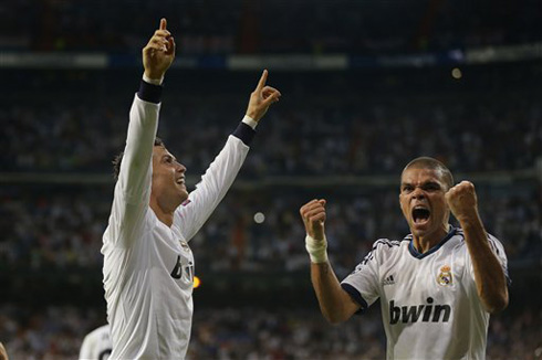 Cristiano Ronaldo pointing his fingers to the Santiago Bernabéu crowd, as he and Pepe celebrate Real Madrid goal against Manchester City, in 2012-2013