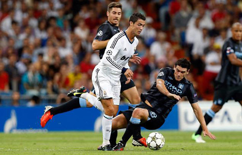 Cristiano Ronaldo leaving Gareth Barry and Javi Garcia behind him, in another run he made in Real Madrid vs Manchester City, in 2012-2013