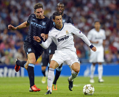 Cristiano Ronaldo holding Javi Garcia charge, in Real Madrid vs Manchester City, for the UEFA Champions League 2012-2013