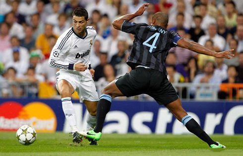 Cristiano Ronaldo dribbling Vincent Kompany, in Real Madrid 3-2 Manchester City, for the UEFA Champions League debut in 2012-2013