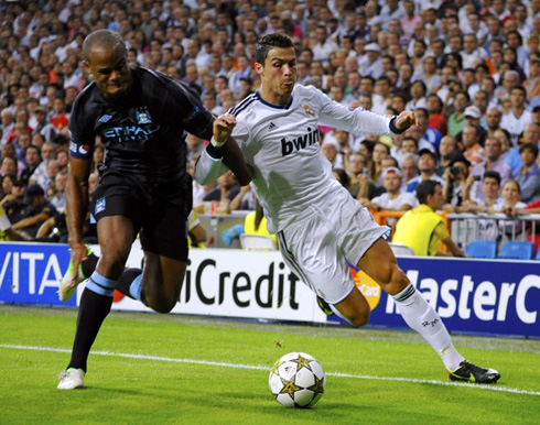 Cristiano Ronaldo fighting with Vincent Kompany for the ball, in Real Madrid 3-2 Manchester City, for the UEFA Champions League in 2012-2013