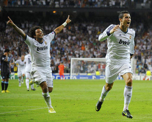 Cristiano Ronaldo and Marcelo running in the Bernabéu to celebrate Real Madrid victory over Manchester City, at the UEFA Champions League debut in 2012-2013