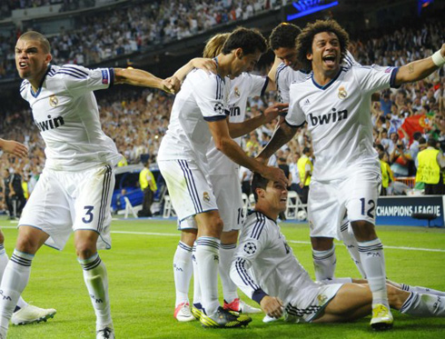 Real Madrid players celebrating all together Ronaldo goal and winner against Manchester City, in the UEFA Champions League 2012-2013