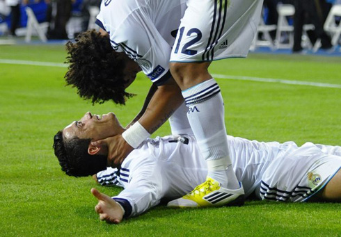 Marcelo holding Cristiano Ronaldo head as they both celebrate Real Madrid 3-2 win against Manchester City, in the UEFA Champions League 2012-2013