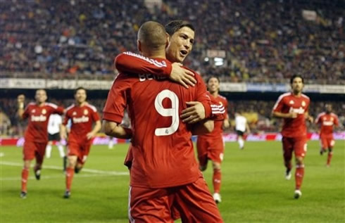 dfc1828ab22 ... 2011-2012 Cristiano Ronaldo huggging and congratulating Karim Benzema  for his goal in Real Madrid