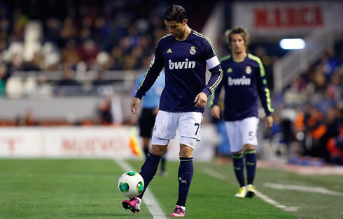 9bb64d442b8 ... in 2013 Cristiano Ronaldo holding the ball at the edge of his pink  football boots