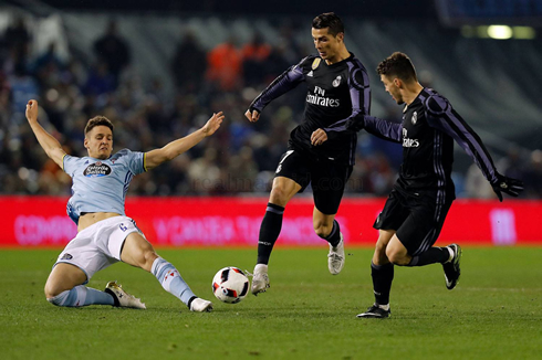 Cristiano Ronaldo Trying To Avoid A Sliding Tackle From A Celta De Vigo Opponent