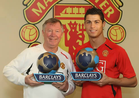 Cristiano Ronaldo and Sir Alex Ferguson holding Barclays Manager and Player of the Month awards