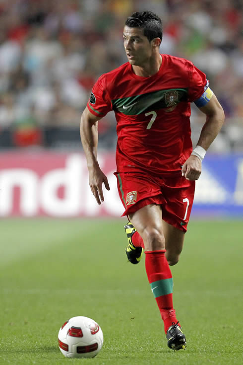 Cristiano Ronaldo wearing the Portuguese National Team captain armband and running with the ball