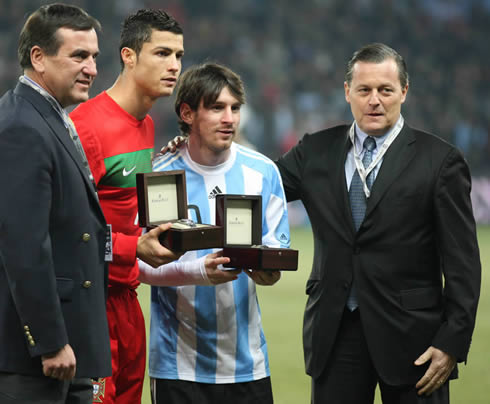 Cristiano Ronaldo and Lionel Messi holding their awards before a game between Portugal and Argentina