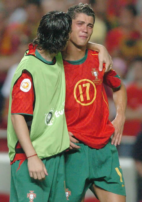 Cristiano Ronaldo crying and being comforted by Tiago, in the EURO 2004 final