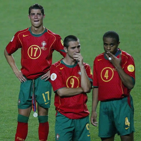 Cristiano Ronaldo crying after Portugal lost to Greece in the EURO 2004 Final, with Pauleta and Jorge Andrade also looking sad near him
