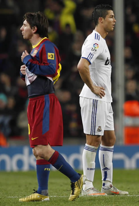 Cristiano Ronaldo and Lionel Messi turning their backs at each other, in a Barcelona vs Real Madrid Clasico