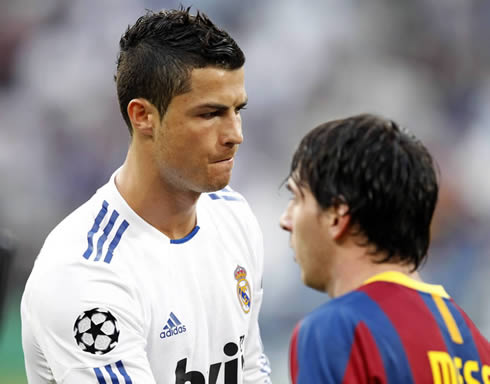 Cristiano Ronaldo and his biggest rival, Lionel Messi, while Real Madrid and Barcelona players salute each other before kickoff