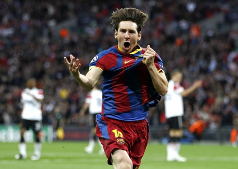 Lionel Messi in Barcelona's goal celebrations in the match against Manchester United, for the UEFA Champions League final, in 2010-2011, while holding his hand to Barcelona badge on his jersey