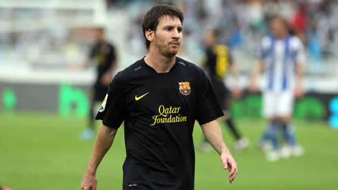 Lionel Messi in a Barcelona black jersey in 2012