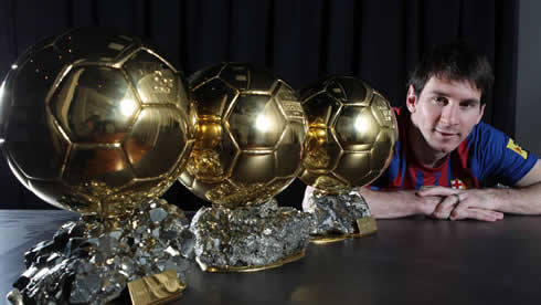 Lionel Messi photo with his 3 FIFA Balon d'Or World Player of the Year trophies/awards in 2012