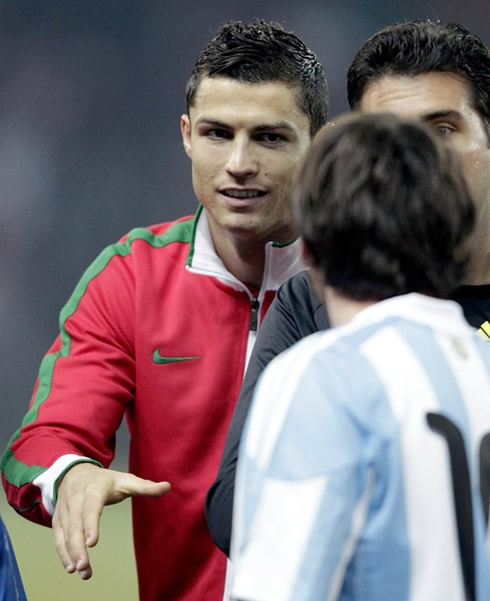 Cristiano Ronaldo saluting Lionel Messi in a Portugal vs Argentina match, in 2011-2012