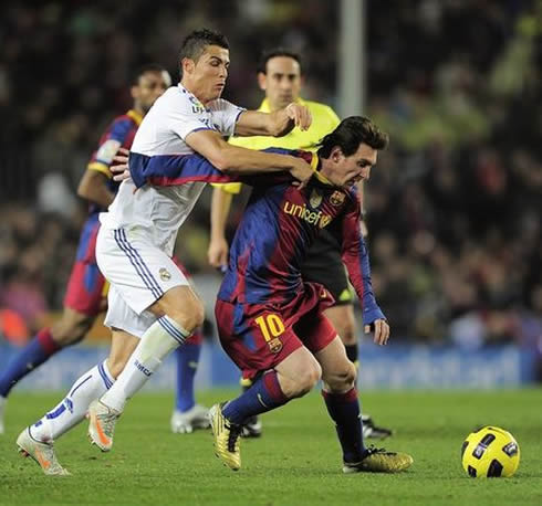 Cristiano Ronaldo tackling and pulling Lionel Messi from behind, in Barcelona vs Real Madrid, in 2011-2012
