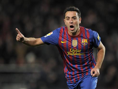 cristiano-ronaldo-457-xavi-celebrating-a-barcelona-goal-at-the-camp-nou-2012.jpg