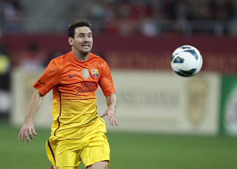 cristiano-ronaldo-542-lionel-messi-chasing-a-ball-with-the-new-orange-and-yellow-barcelona-shirt-jersey-and-kit-for-2012-2013.jpg
