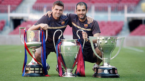 Pep Guardiola and Tito Vilanova posing for a photo with Barcelona trophies
