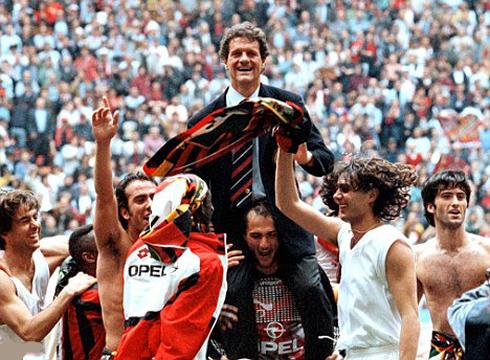 Fabio Capello celebrating AC Milan's title in the Italian League Serie A, with Paolo Maldini and Alessandro Nesta