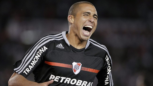 David Trézéguet in a black River Plate jersey and shirt, sponsored by PetroBras, in 2012-2013