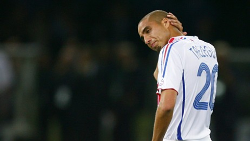 David Trézéguet scratching his bald head in a game for the French National Team