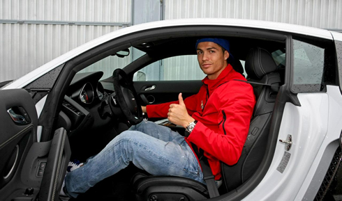 Cristiano Ronaldo inside his new Audi R8 car, given to Real Madrid players in 2012-2013