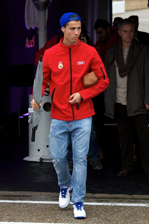 Cristiano Ronaldo with a red Audi jacket, walking towards his new Audi R8 car, given to all Real Madrid players in 2012-2013