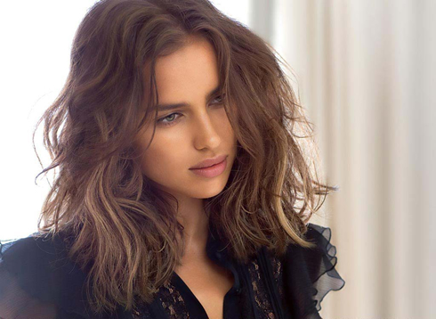 Irina Shayk messy hair falling in front of her perfect face