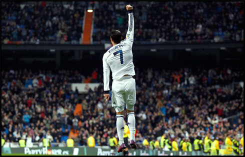 Cristiano Ronaldo jumping high in Real Madrid's goal celebration, in 2013