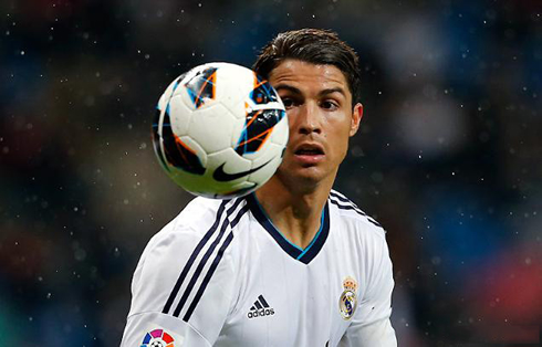 Cristiano Ronaldo near a football, in a Real Madrid game in 2013