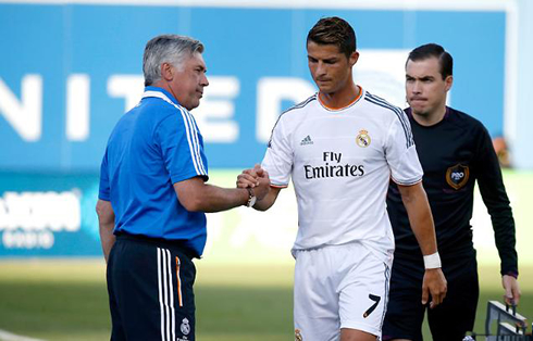 Cristiano Ronaldo giving an hand shake to Carlo Ancelotti, in Real Madrid 2013